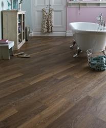 Welcoming bathroom with dark Karndean flooring