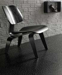 A modern, dark Karndean flooring design in mature room