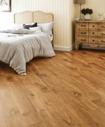 Comforting Karndean flooring in large bedroom